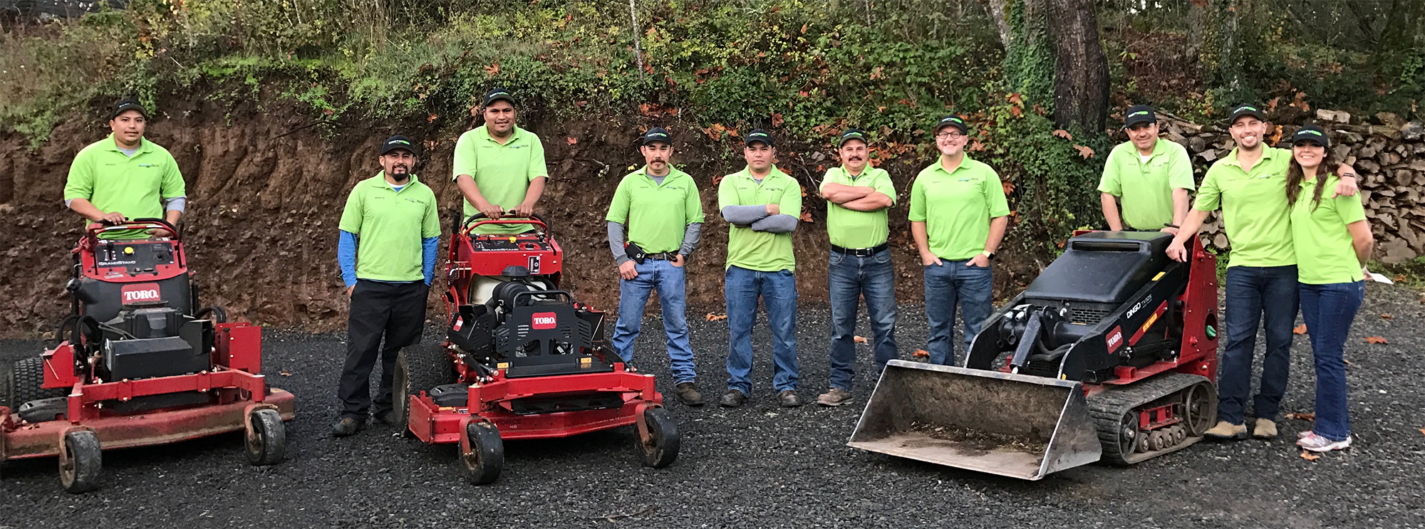 Earth Tech Landscaping Team with Lawn Mowers and Equipment